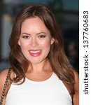 Small photo of Tanya Burr arriving for the FHM 100 Sexiest Women in the World 2013 party at the Sanderson Hotel, London. 01/05/2013