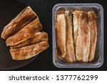 Stock photo marinated fillet mackerel or fillet herring fish with spices packed in box on plate over slate 1377762299