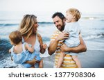 a young family with two toddler ... | Shutterstock . vector #1377908306