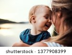 a close up of mother with a... | Shutterstock . vector #1377908399
