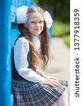 schoolgirl in school uniform... | Shutterstock . vector #1377918359