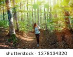 young woman taking a walk in... | Shutterstock . vector #1378134320