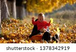mother laying on her back on... | Shutterstock . vector #1378342919