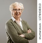 charming senior lady posing... | Shutterstock . vector #1378438313