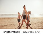 smiling mom and her two... | Shutterstock . vector #1378488470