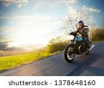 motorcycle driver riding in... | Shutterstock . vector #1378648160