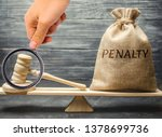Small photo of Bag with the word Penalty and gavel on the scales. Penalty as a punishment for a crime and offense. Fraud. The court's decision. Appeal. Cancellation of fines and financial penalties. Litigation