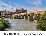 view of roman bridge of cordoba ... | Shutterstock . vector #1378717730