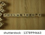 Small photo of Philanthropy word from wooden blocks on desk