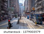 Small photo of Main street, Hong Kong - September 2018 : Transportation in HK with city bus and double-deck trams, the most affordable, convenient and greenest public transport mode in the Hongkong city.