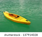 Kayak Boat Floating On The Sea