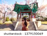 korean lady travel and take... | Shutterstock . vector #1379150069