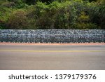 gabion stone wall to protect... | Shutterstock . vector #1379179376
