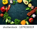 fresh vegetables on a black...