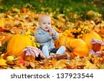 Cute Baby Boy With Pumpkins In...