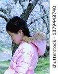 asian long haired girl wearing... | Shutterstock . vector #1379448740