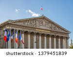 Small photo of National assembly facade in Paris, France under the blue sky. Assemblee Nationale with French and EU flags