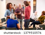 group of people socializing... | Shutterstock . vector #1379510576