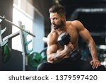 strong muscular man with naked... | Shutterstock . vector #1379597420