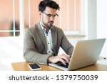 shot of handsome young business ... | Shutterstock . vector #1379750039