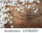 Stock photo white petals on wooden background 137982059