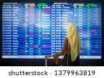 muslim female traveller at the... | Shutterstock . vector #1379963819