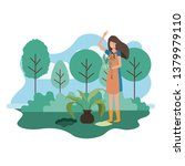 woman with tree to plant in...   Shutterstock .eps vector #1379979110