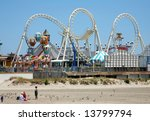 Amusement park on beach with blue sky - stock photo