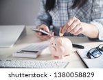 business girl putting coin in a ... | Shutterstock . vector #1380058829