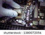 expert is inserting cpu ... | Shutterstock . vector #1380072056
