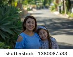 latina mother and daughter... | Shutterstock . vector #1380087533
