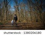 Dad And Toddler Walking On...