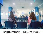 Small photo of people in a waiting room of hospital, men and women wait their turn