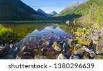 picturesque forest lake in the... | Shutterstock . vector #1380296639