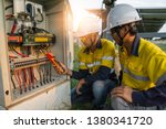 Workers Use Clamp Meter To...