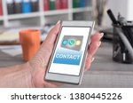 female hand holding a... | Shutterstock . vector #1380445226