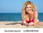 attractive woman on a seacoast | Shutterstock . vector #138048500