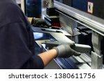 employee operates bending... | Shutterstock . vector #1380611756