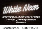 white neon script alphabet font.... | Shutterstock .eps vector #1380646919