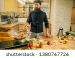 male chef cooking meat with... | Shutterstock . vector #1380767726
