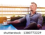 man in his 50s sitting on sunny ... | Shutterstock . vector #1380772229