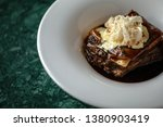 meat in bbq sauce standing on... | Shutterstock . vector #1380903419