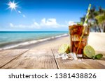 summer drink on wooden table... | Shutterstock . vector #1381438826