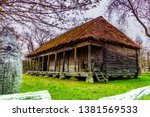 a wooden house with a hay roof... | Shutterstock . vector #1381569533