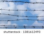 barbed wire against the blue... | Shutterstock . vector #1381612493