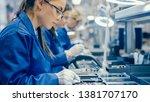 female electronics factory... | Shutterstock . vector #1381707170