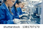 Female Electronics Factory...