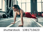 Attractive sporty woman in gym. ...