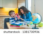mother helping with homework to ... | Shutterstock . vector #1381730936