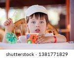 cute little boy eating ice...   Shutterstock . vector #1381771829